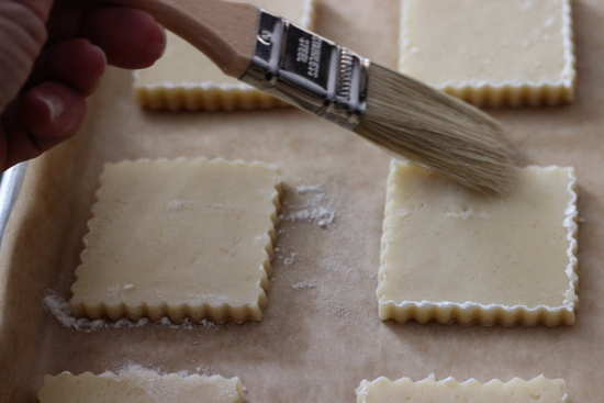 Wipe off flour using pastry brush