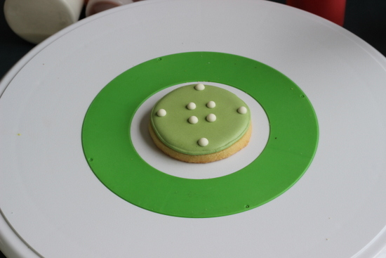 Raised dots on royal icing