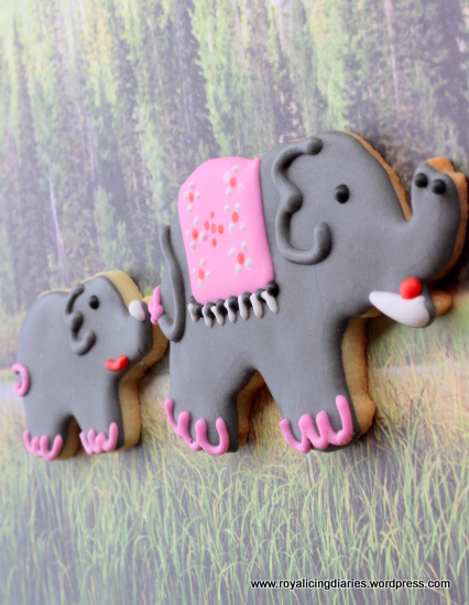 Elephant cookies - following mom in the grass