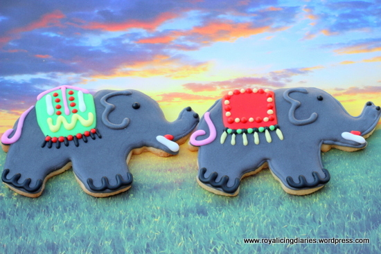Two elephant cookies at sunset